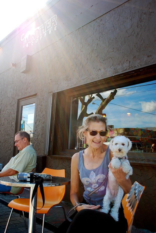 A happy customer outside Panther Coffee with her puppy in Wynwood
