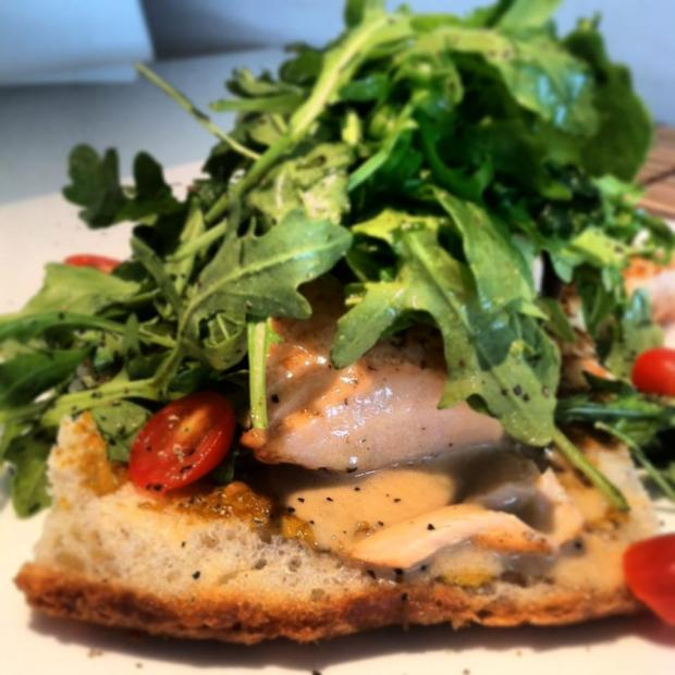 Fresh Arugula on Salmon served on fresh homemade focaccia at N-O-A Cafe in Wynwood